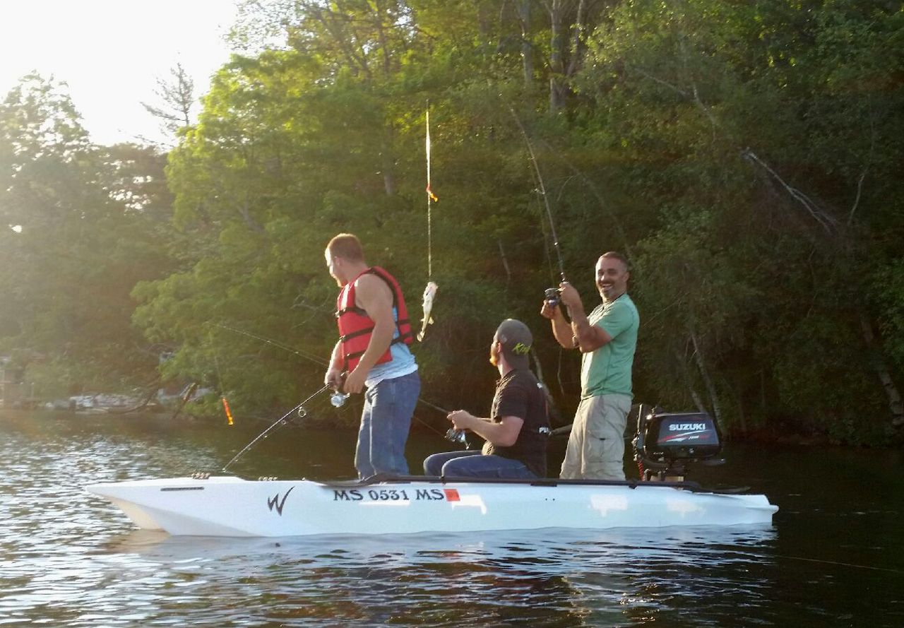 three anglers fishing standing in the most stable fishing kayak, the Wavewalk S4