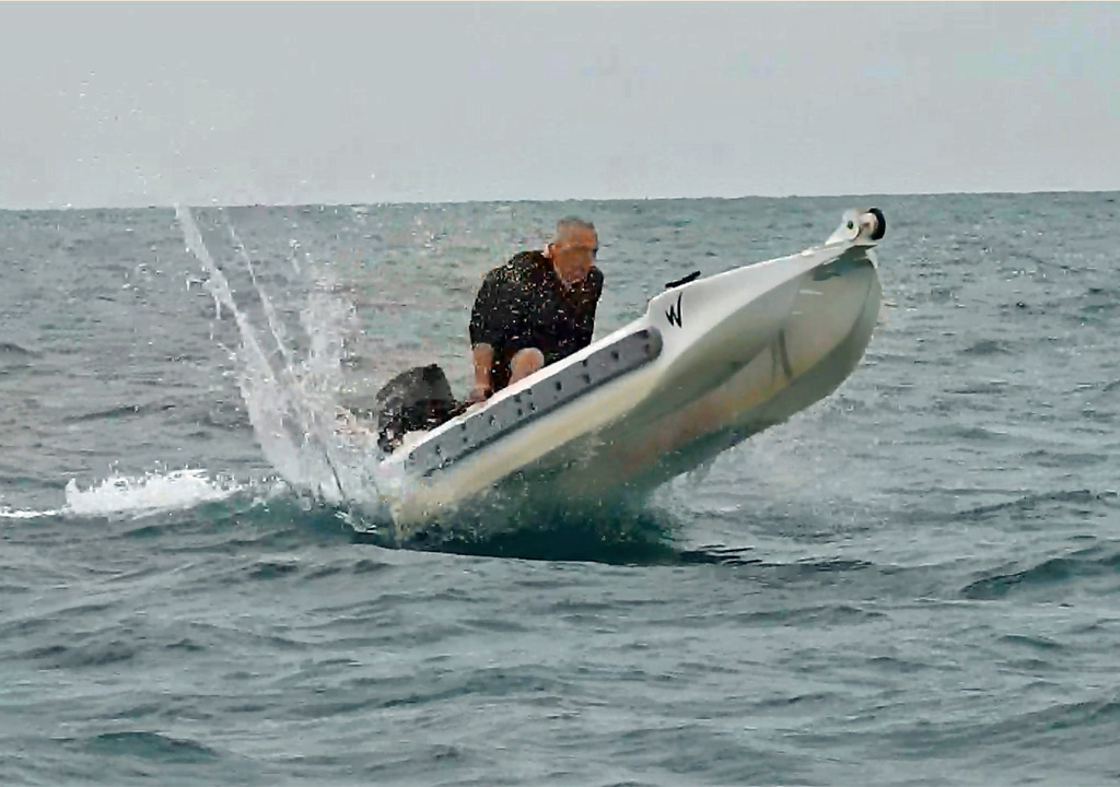 S4 motor kayak powered by 10 HP outboard