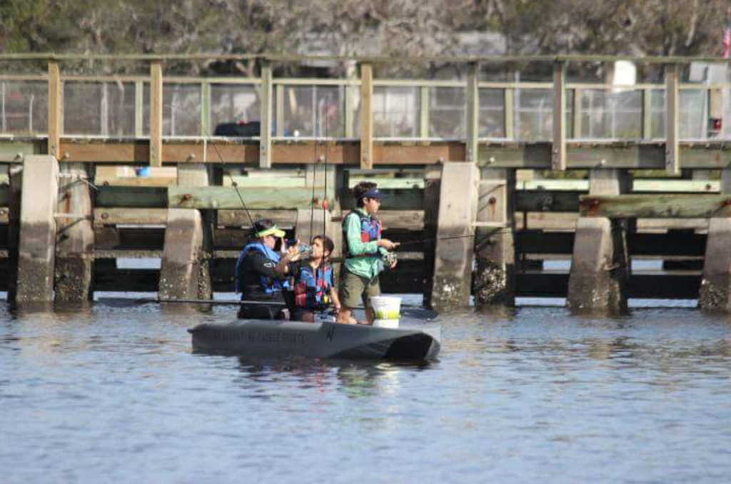 family fishing out of a Wavewalk S4 kayak