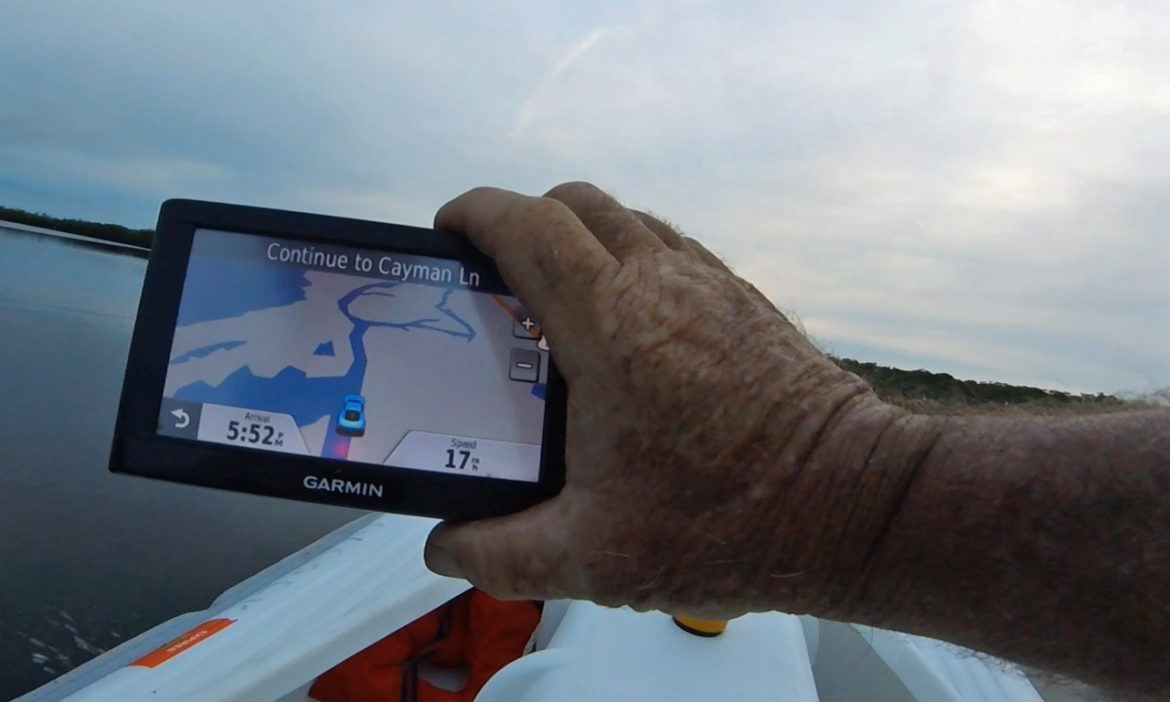 Driving an S4 cat microskiff with a 9.8 HP Tohatsu outboard at 17 mph