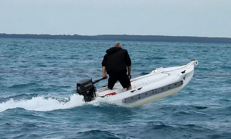 Wavewalk S4 portable seaworthy microskiff - Driviing standing in ocean chop