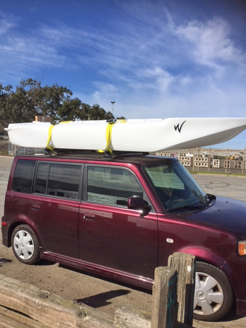 S4 kayak car topped on small SUV