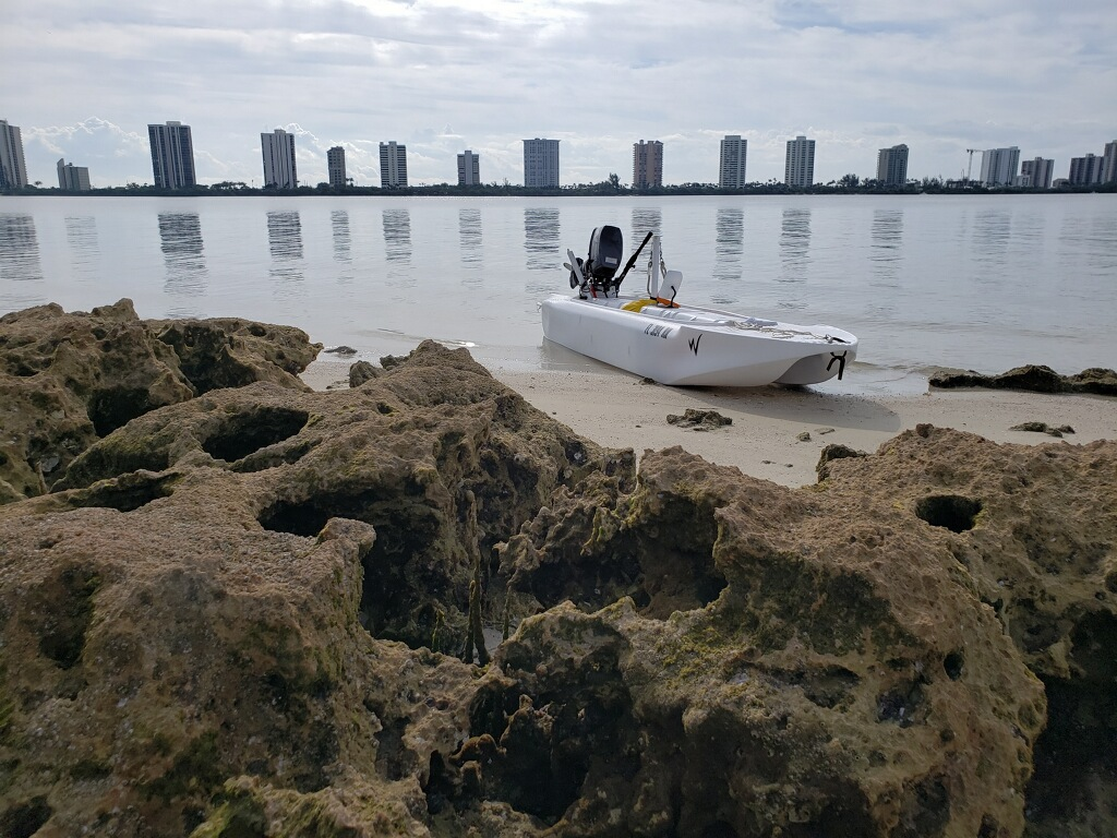 S4 skiff beached with West Palm Beach hotels in the background
