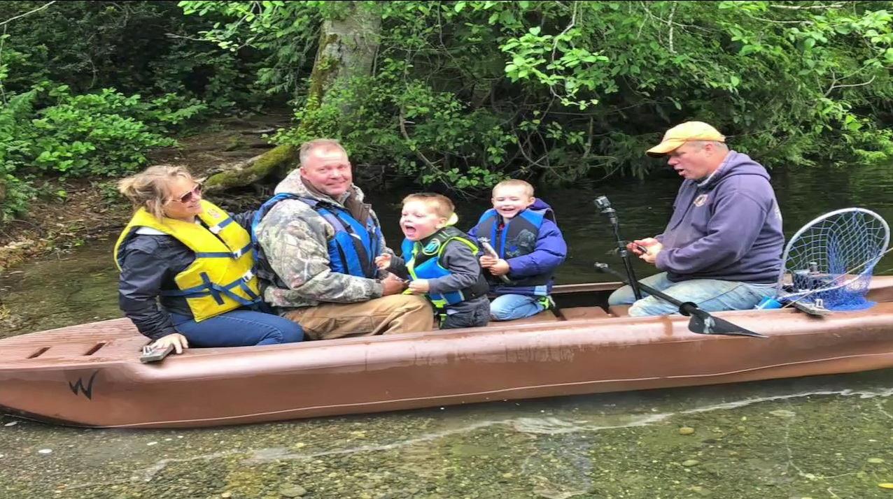 Adults and kids on board a Wavewalk S4 kayak