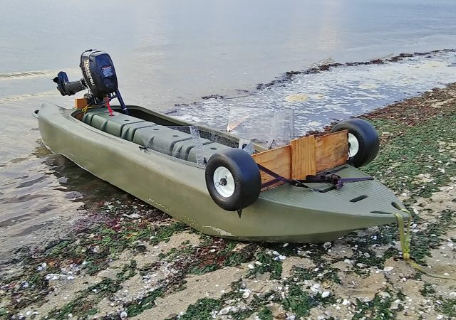 S4 micro skiff beached on the sand
