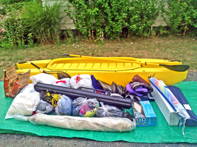 How much fishing and camoing gear can be stored in a W500 kayak