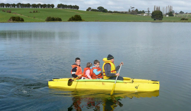 Wavewalk 500 kayak with 4 passengers on board- One adult and three children