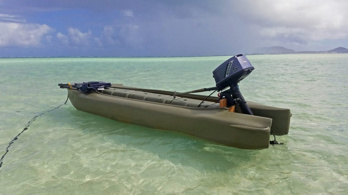 Wavewalk S4 motor kayak with 5 HP outboard, Hawaii