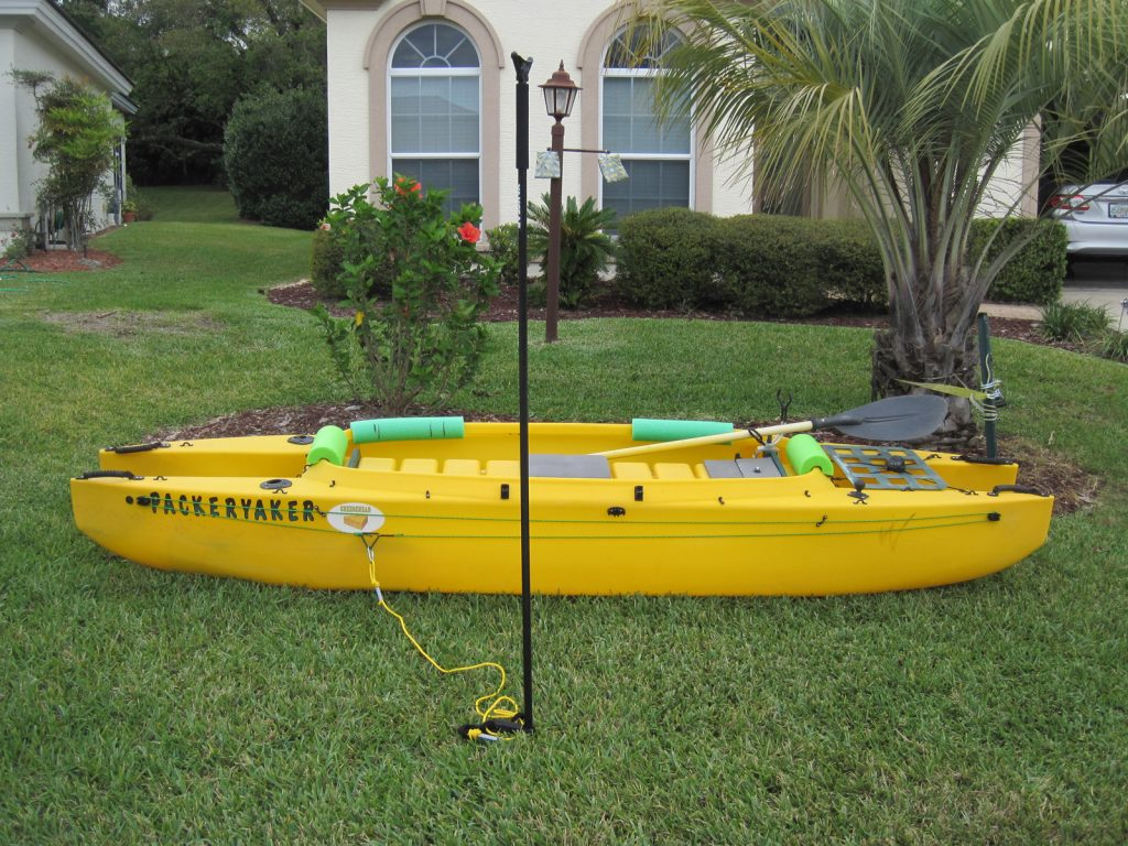 Wavewalk 500 fishing kayak outfitted with an anchor trolley and stake out pole