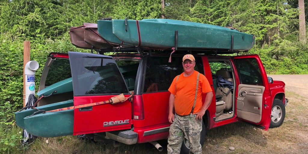 4 fishing kayaks transported in SUV