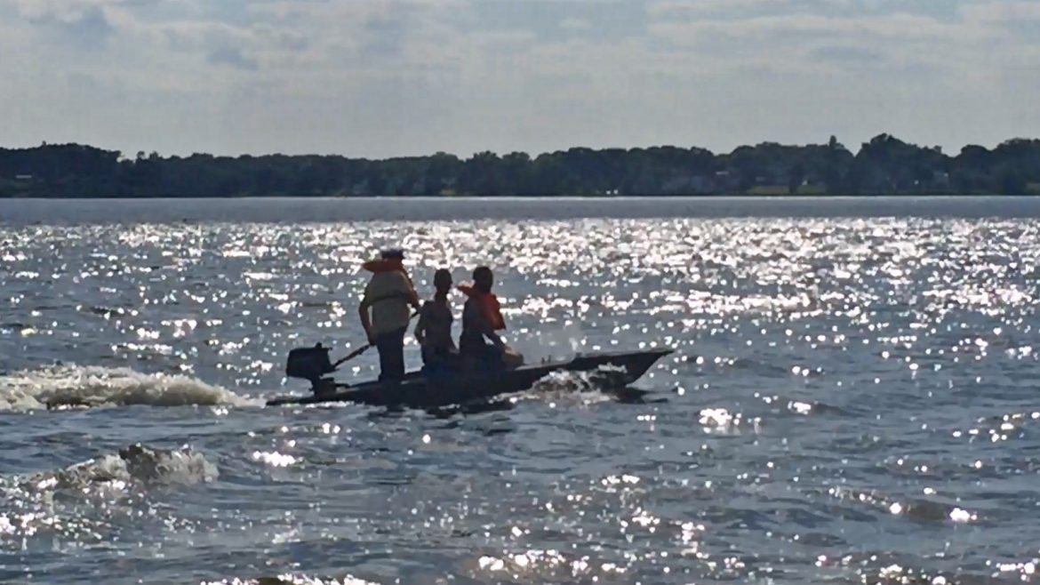 3 guys in a Wavewalk S4 motor tandem kayak skiff
