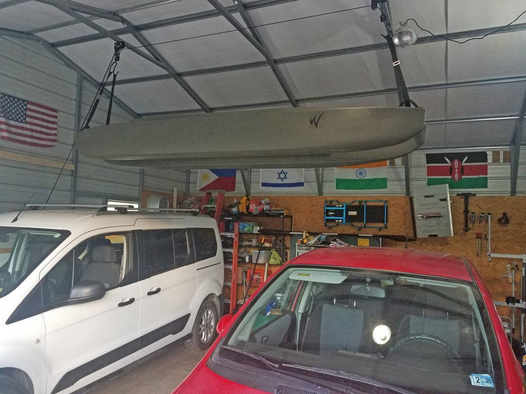 W700 tandem kayak stored under the roof of a garage