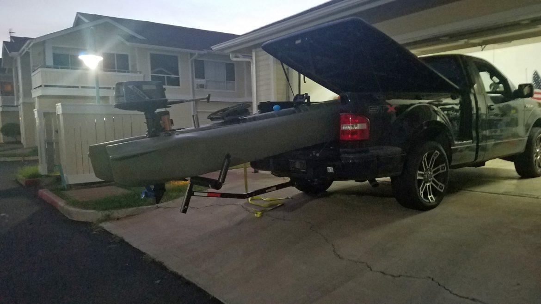 Wavewalk S4 motorized fishing kayak transported on pickup truck bed