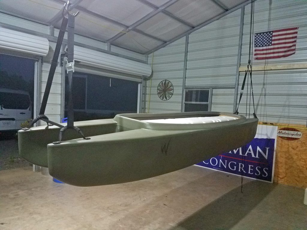 W700 tandem kayak stored in a garage