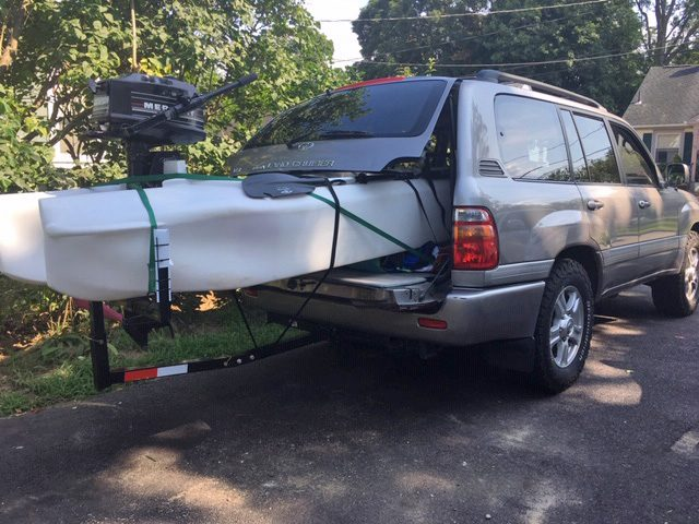 S4 motor kayak transported inside an SUV outfitted with a T-extension