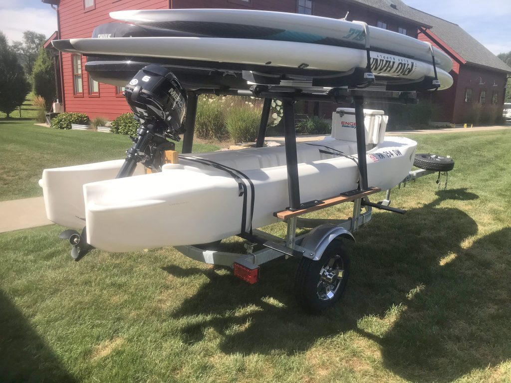 S4 motor kayak skiff on trailer