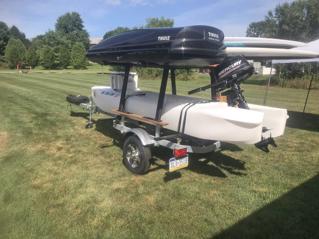 S4 motor kayak skiff with 6 HP Mercury outboard on a trailer