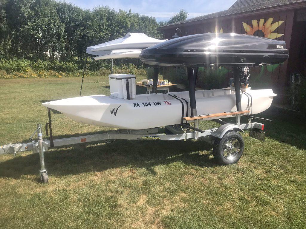 S4 motor kayak skiff transported on a trailer