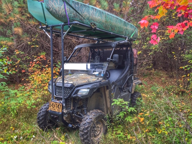 Rack for transporting kayak on ATV