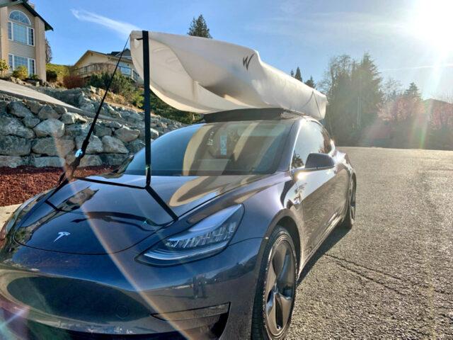 Wavewalk S4 transported on top of electric sedan