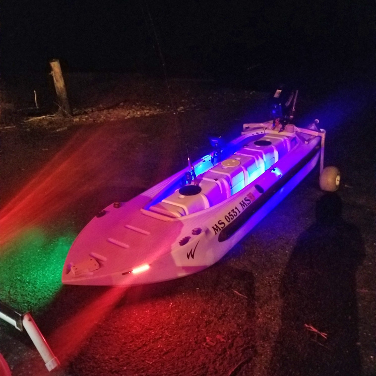 Motorized kayak skiff outfitted with electric lights for night fishing