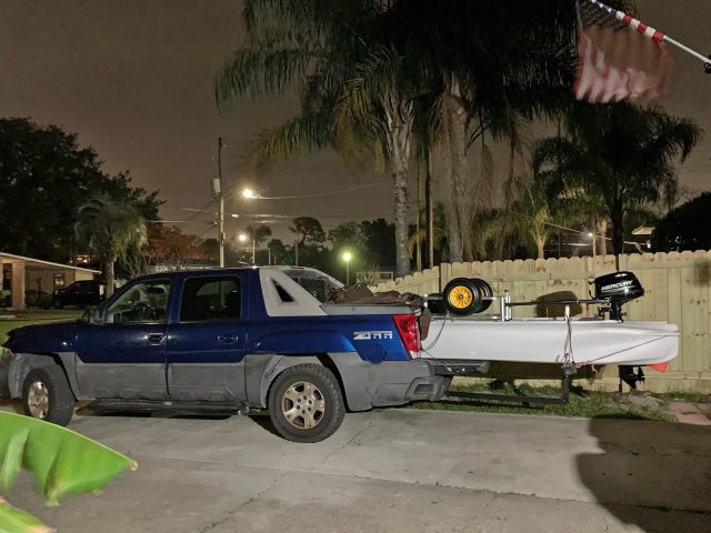 Pickup truck carrying S4 motor kayak skiff on truck bed