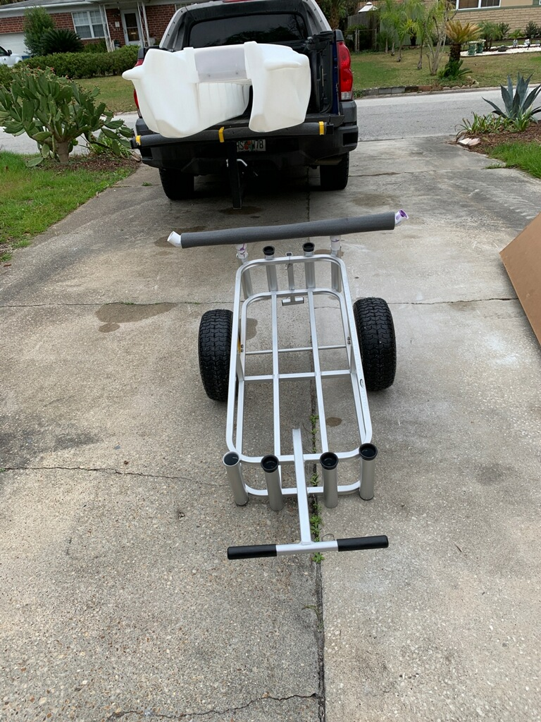 S4 catamaran micro skiff on pickup truck bed, and cart for carrying