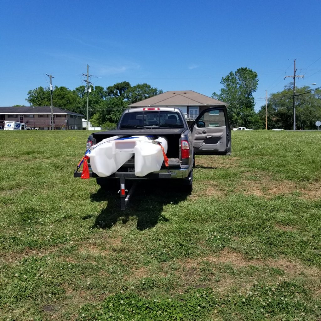 S4 microskiff transported on pickup truck bed