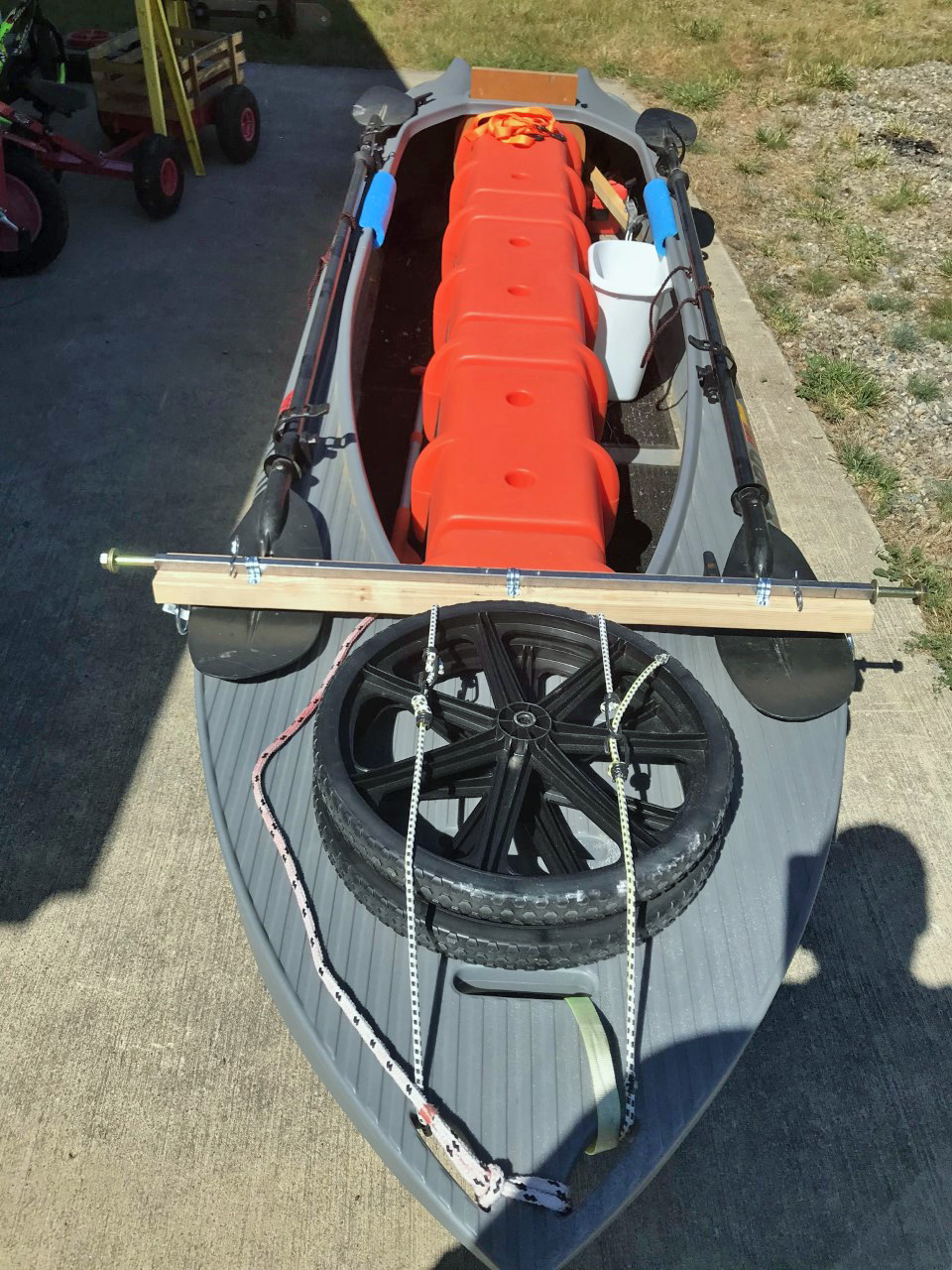 DIY cart wheel disassembled and attached to the kayak