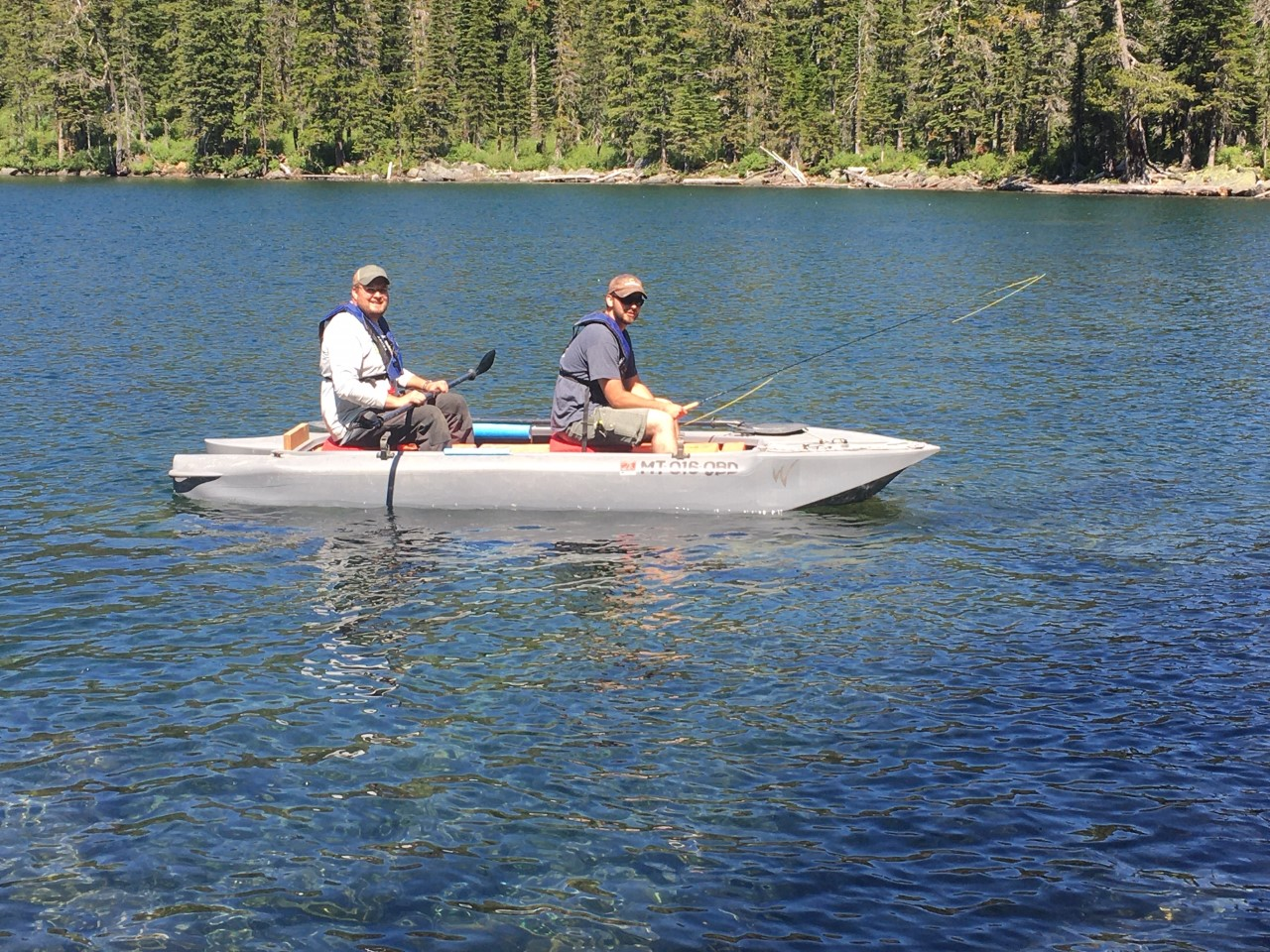 Tow anglers fishing from a Wavewalk S4 kayak in lake Hawkin, Montana