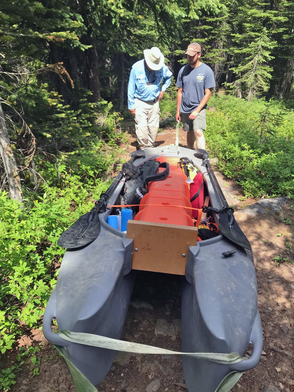Carrying (portaging) the S4 tandem fishing kayak through rugged terrain
