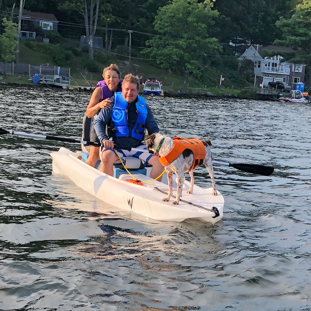 Wavewalk S4 cartop skiff outfitted with a pair of swivel seats, and a dog standing on its front deck