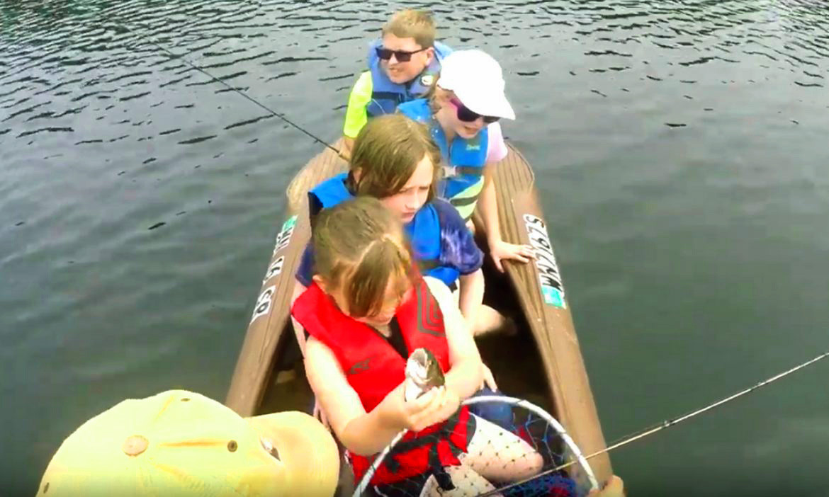 Children fishing from a Wavewalk S4 kayak